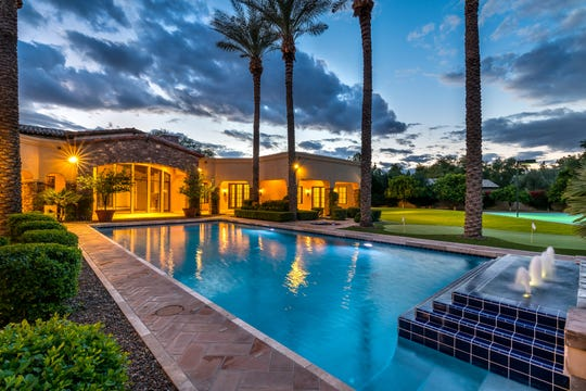 The Tuscan-style Paradise Valley mansion, purchased by Rajeev and Cynthia Kathuria, includes a resort-style pool, putting green and sport court.