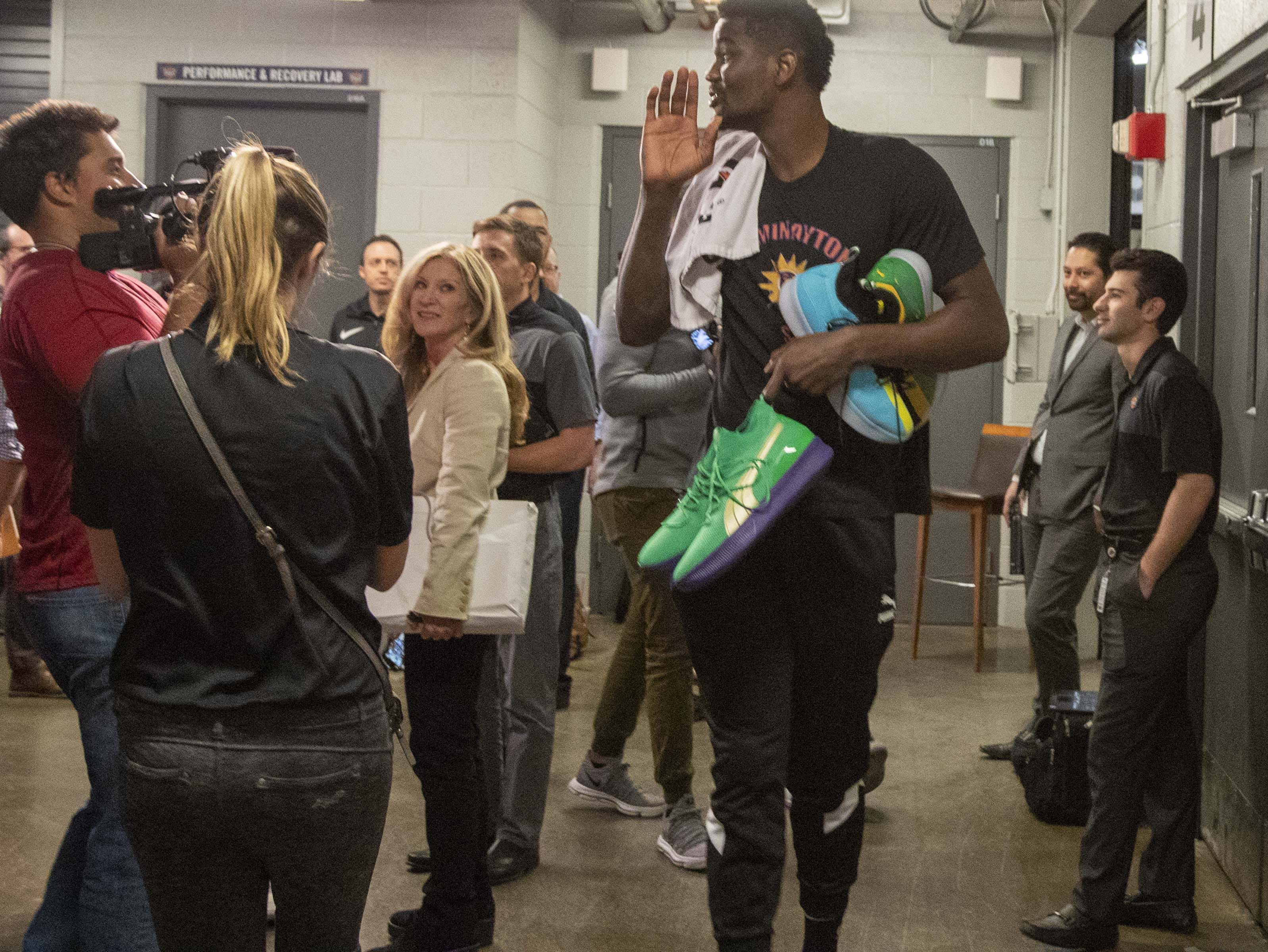 Deandre Ayton carries several pairs of shoes with him during the Suns' exit interviews on April 10.
