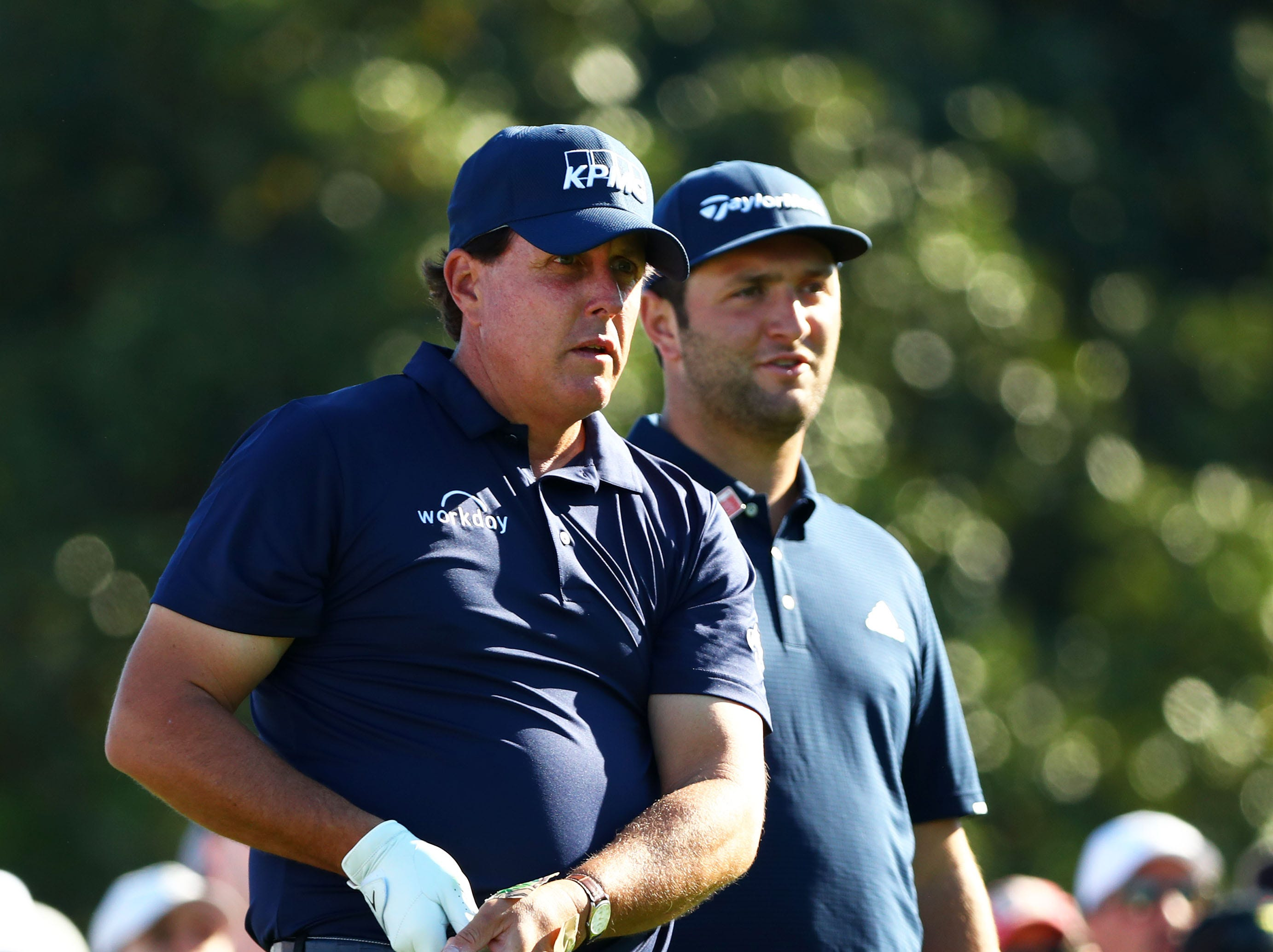 Apr 10, 2019; Augusta, GA, USA; Masters champion Phil Mickelson and Jon Rahm of Spain at the 10th tee box during a practice round for The Masters golf tournament at Augusta National Golf Club. Mandatory Credit: Rob Schumacher-USA TODAY Sports