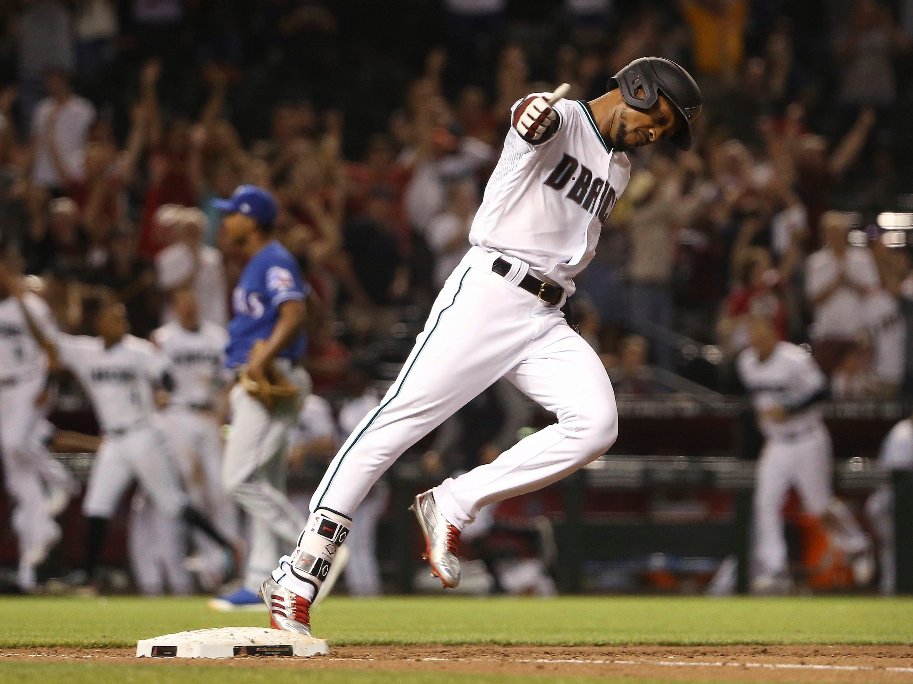 Arizona Diamondbacks' Jarrod Dyson celebrates his two-run walk-off home run against the Texas Rangers in a baseball game Tuesday, April 9, 2019, in Phoenix. The Diamondbacks defeated the Rangers 5-4. (AP Photo/Ross D. Franklin)