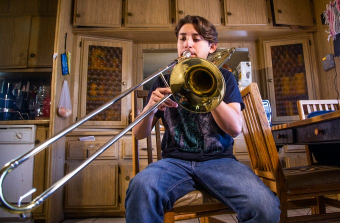Samuel Osornio, 15, a student at Mesa High School, practices his trombone at home, Feb. 22, 2019. Osornio was suspended from school for throwing a punch at a classmate, who, according to Osornio, was threatening him.