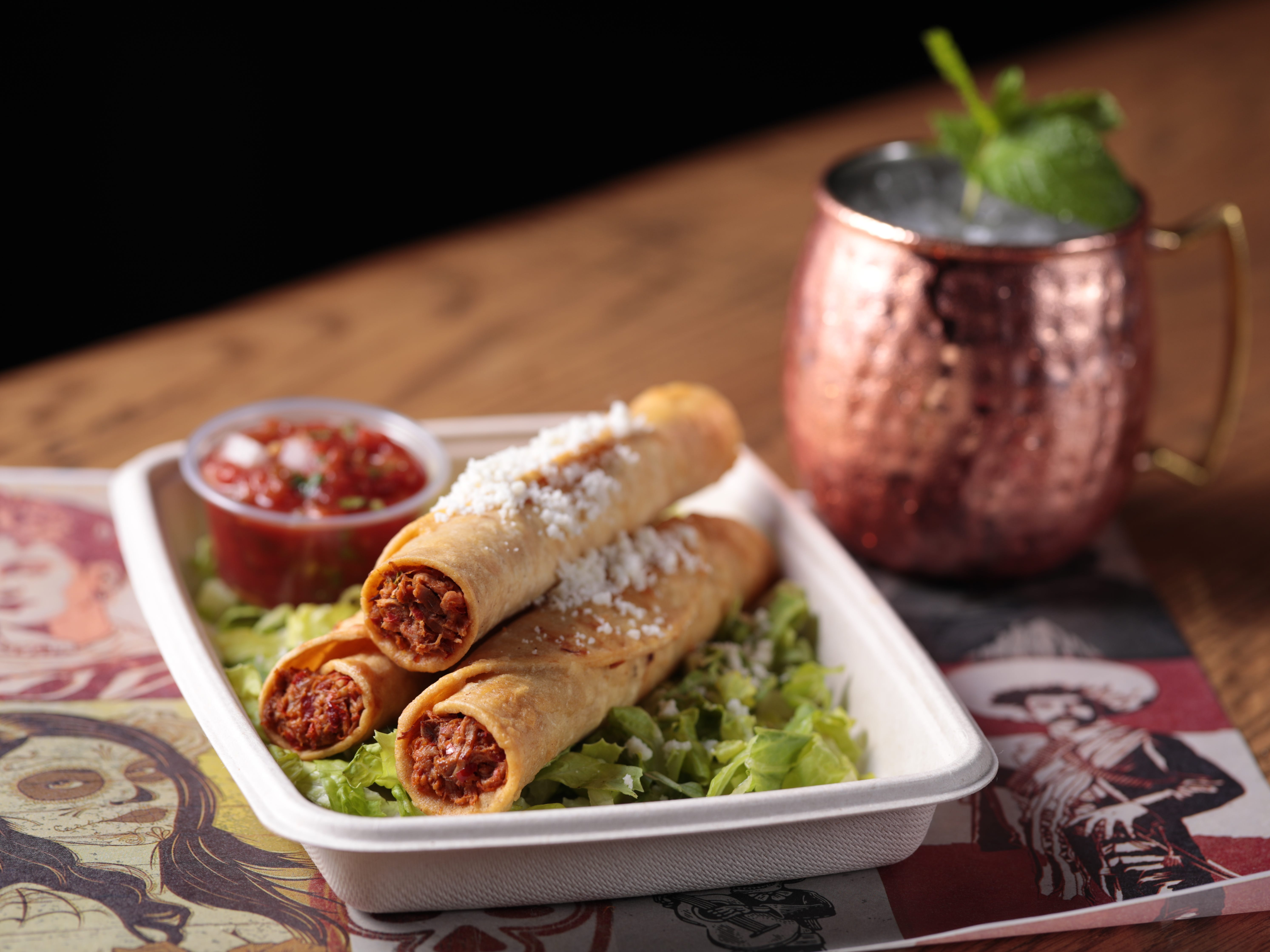 The taquitos at George Lopez's Chingon Kitchen are stuffed with beef machaca and served with avocado salsa, cotija cheese and crema.