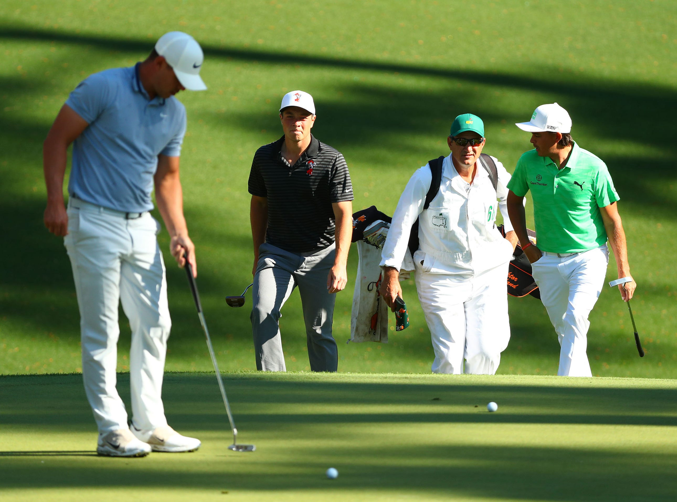 Apr 10, 2019; Augusta, GA, USA; Brooks Koepka (left), amateur Viktor Hovland (center) and Rickie Fowler arrive at the 10th green during a practice round for The Masters golf tournament at Augusta National Golf Club. Mandatory Credit: Rob Schumacher-USA TODAY Sports