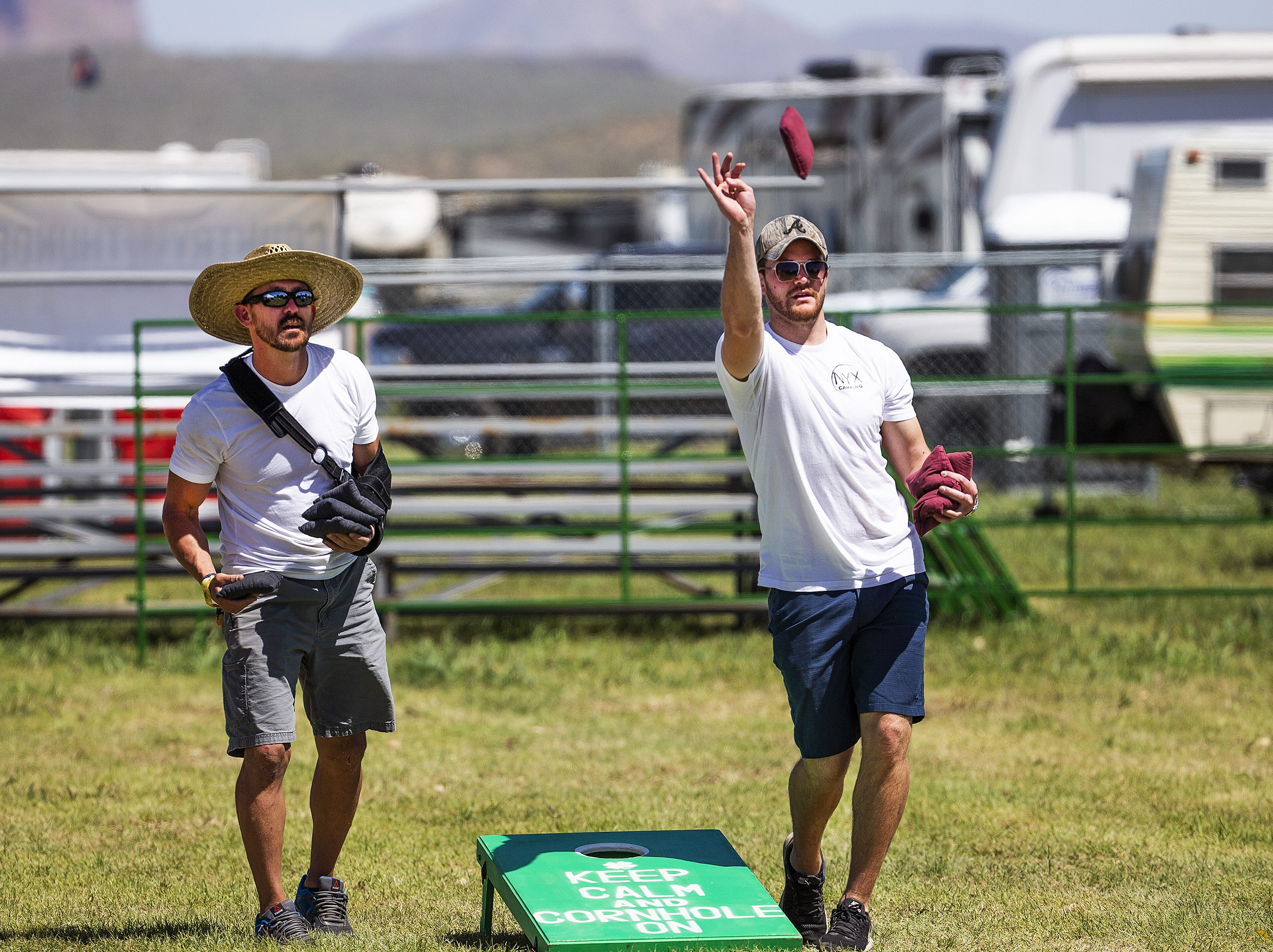Cousins Kevin Hinsberg, left, 46, of Peoria, and Nick Hinsberg, 27 from Mission Viejo, California, play cornhole at a campsite at the Country Thunder Arizona 2019 music festival outside Florence, April 10, 2019.