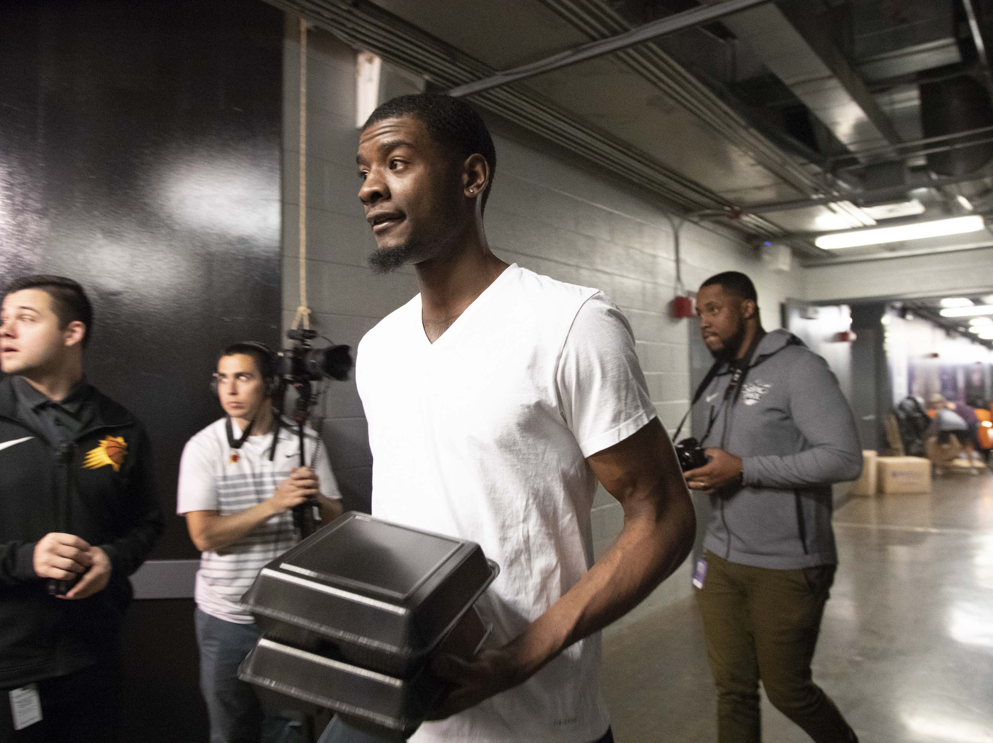 Josh Jackson heads to his exit interview following the Suns' 2018-19 season.