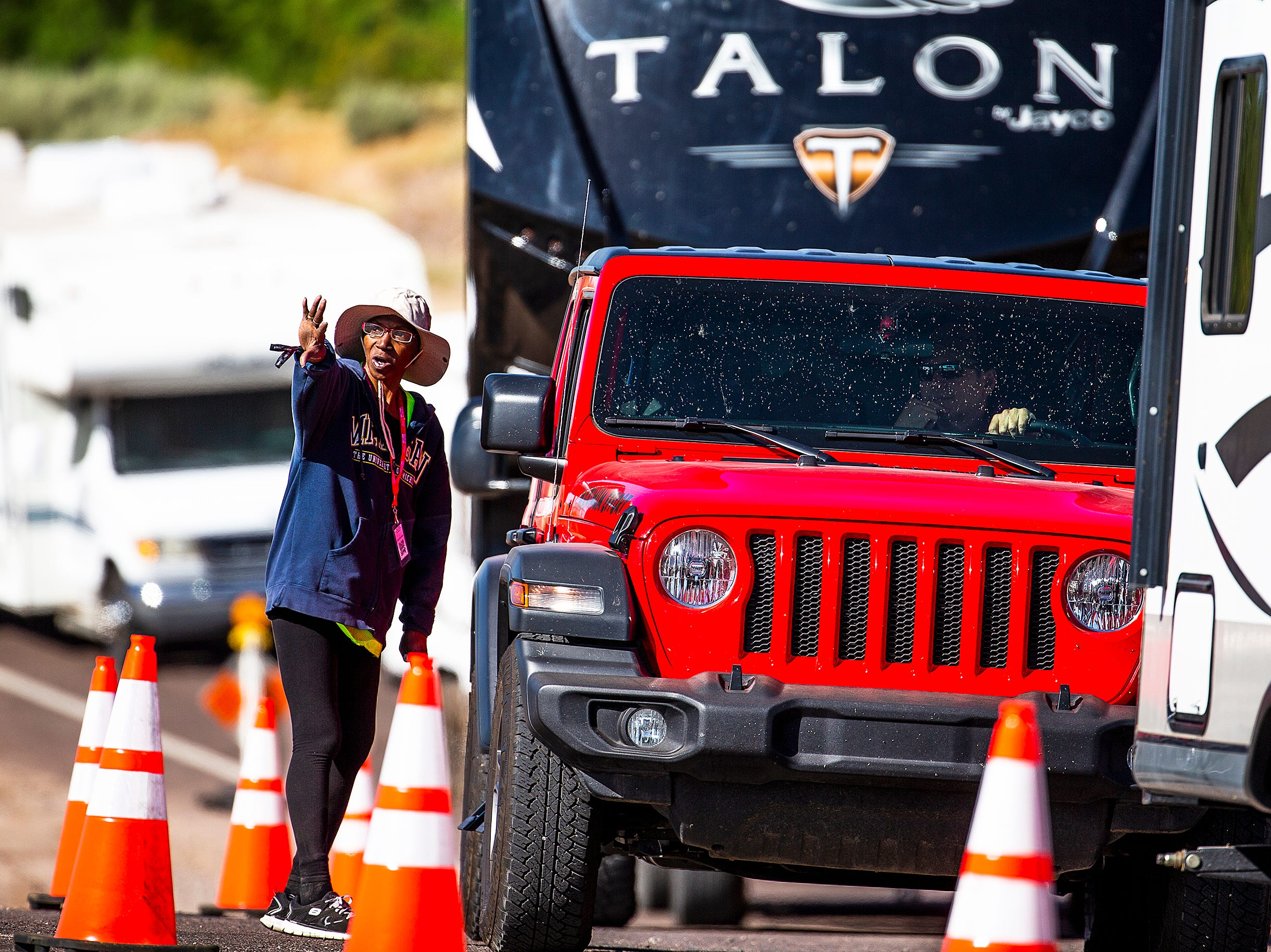 Hundreds of vehicles, including campers and trailers, enter the Country Thunder Arizona 2019 music festival April 10, 2019.