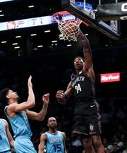 Nets forward Rondae Hollis-Jefferson puts up a shot over Hornets guard Jeremy Lamb on March 1.