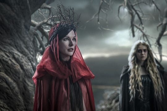 "Milla Jovovich (left) and Penelope Mitchell star in ""Hellboy."""