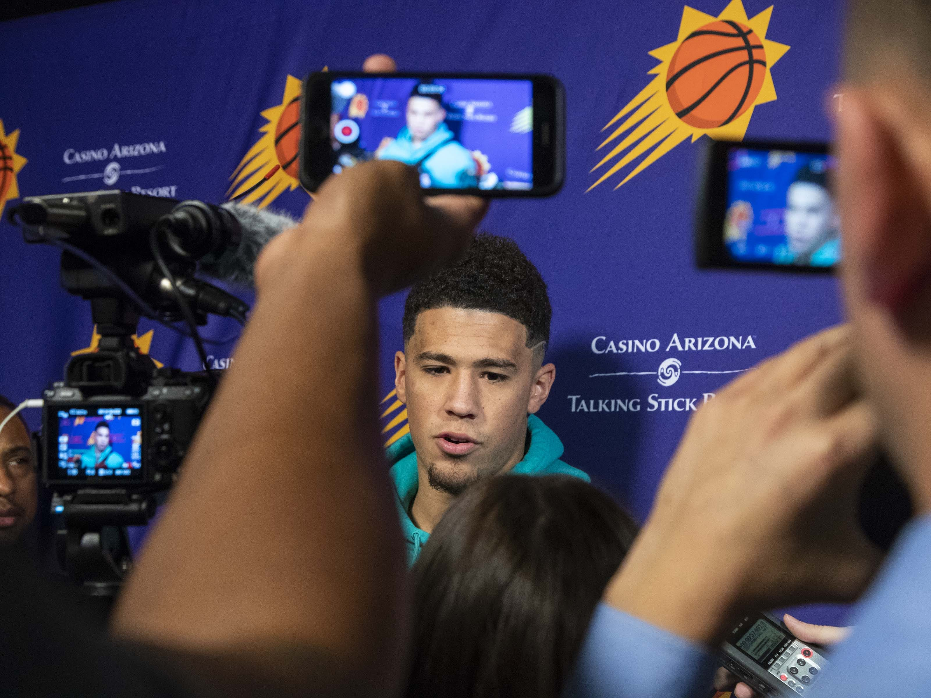Devin Booker answers questions during the Suns' exit interviews on APril 10 at at Talking Stick Resort Arena.