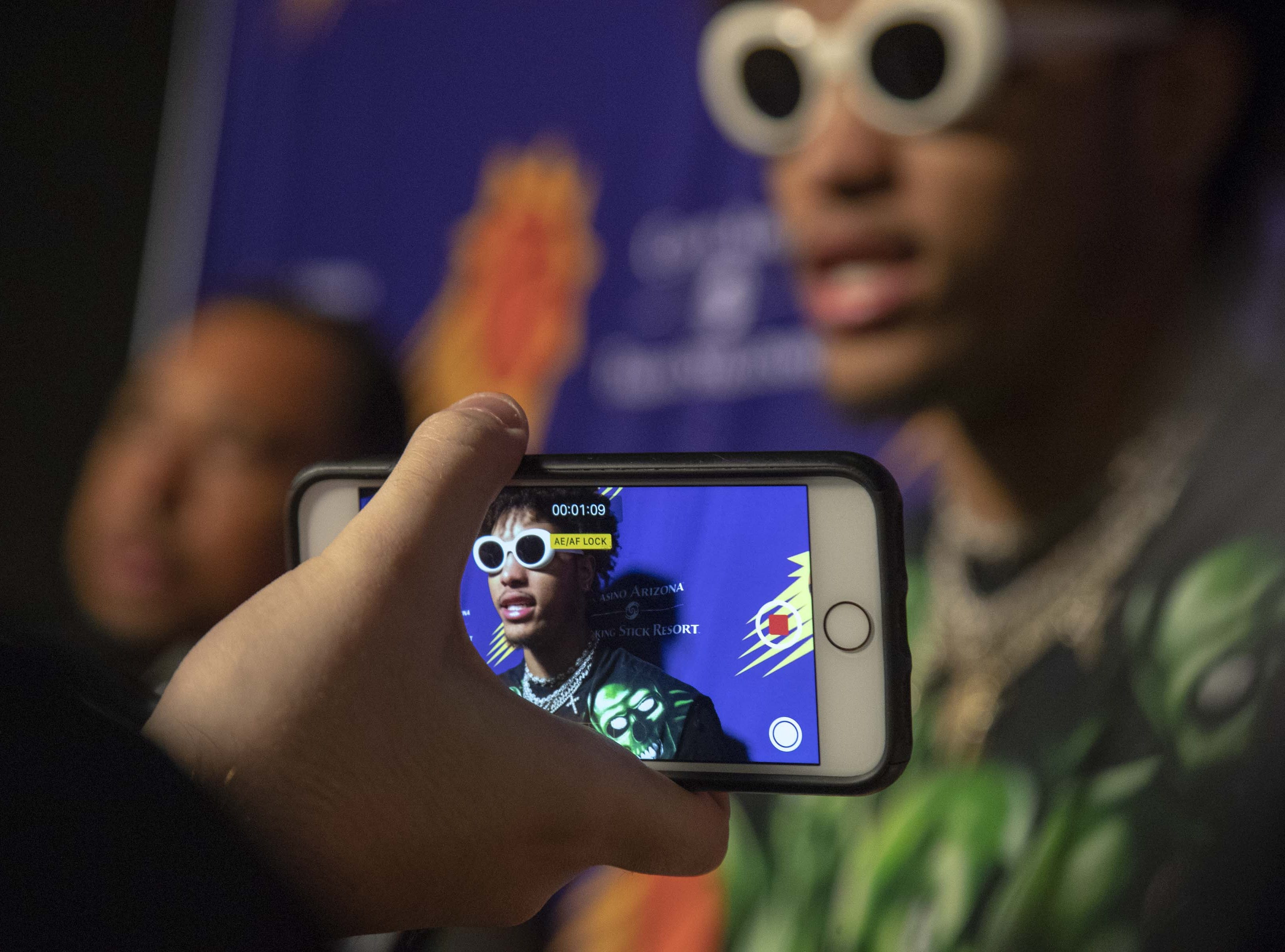 Kelly Oubre Jr. is seen on a cell phone screen during his exit interview following the Suns' 2018-19 season.
