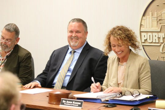 Newly appointed Port Clinton Mayor Mike Snider takes his first seat in the position after being sworn in at the Port Clinton City Council meeting on Tuesday.