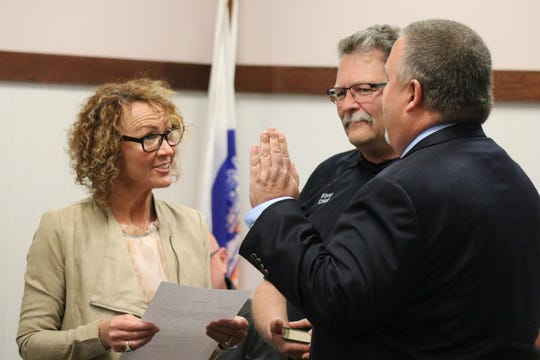 Port Clinton City Council President De Anna Kuzma administers the oath of office to newly appointed Mayor Mike Snider at the City Council meeting on Tuesday.