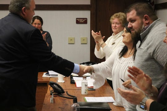 Newly appointed Port Clinton Mayor Mike Snider shakes hands with Port Clinton City Council members on Tuesday.