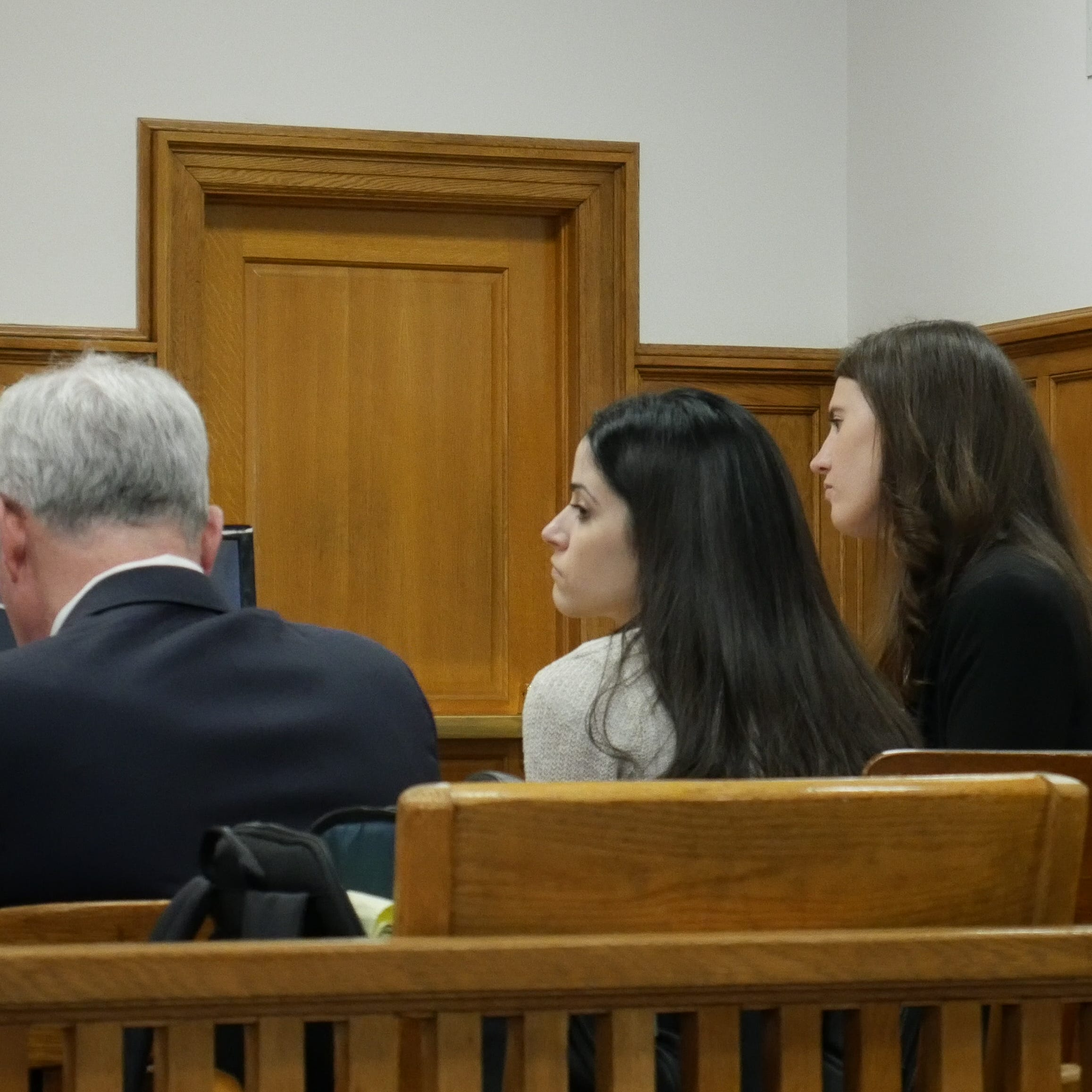Nicole Addimando, center, sits with members of her legal team in Dutchess County Court on April 10, 2019. At left is attorney Benjamin Ostrer and at right is attorney Elizabeth Hood.