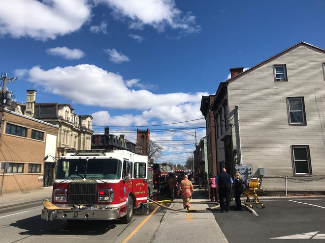 """Firefighters respond to a kitchen fire on Mill Street in the City of Poughkeepsie on Wednesday afternoon. One apartment was left in """"unlivable"""" conditions, according to Fire Chief Mark Johnson."""