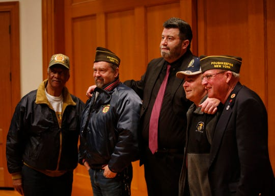 Marist College English Professor Tommy Zurhellen, center, with fellow members of Poughkeepsie VFW Post 170, from left, Dave Gunn, Nathan Grant, James Metrando and Mike Brady at Marist on April 10, 2019.  Zurhellen plans to Walk across the United States to raise awareness for veterans issues.