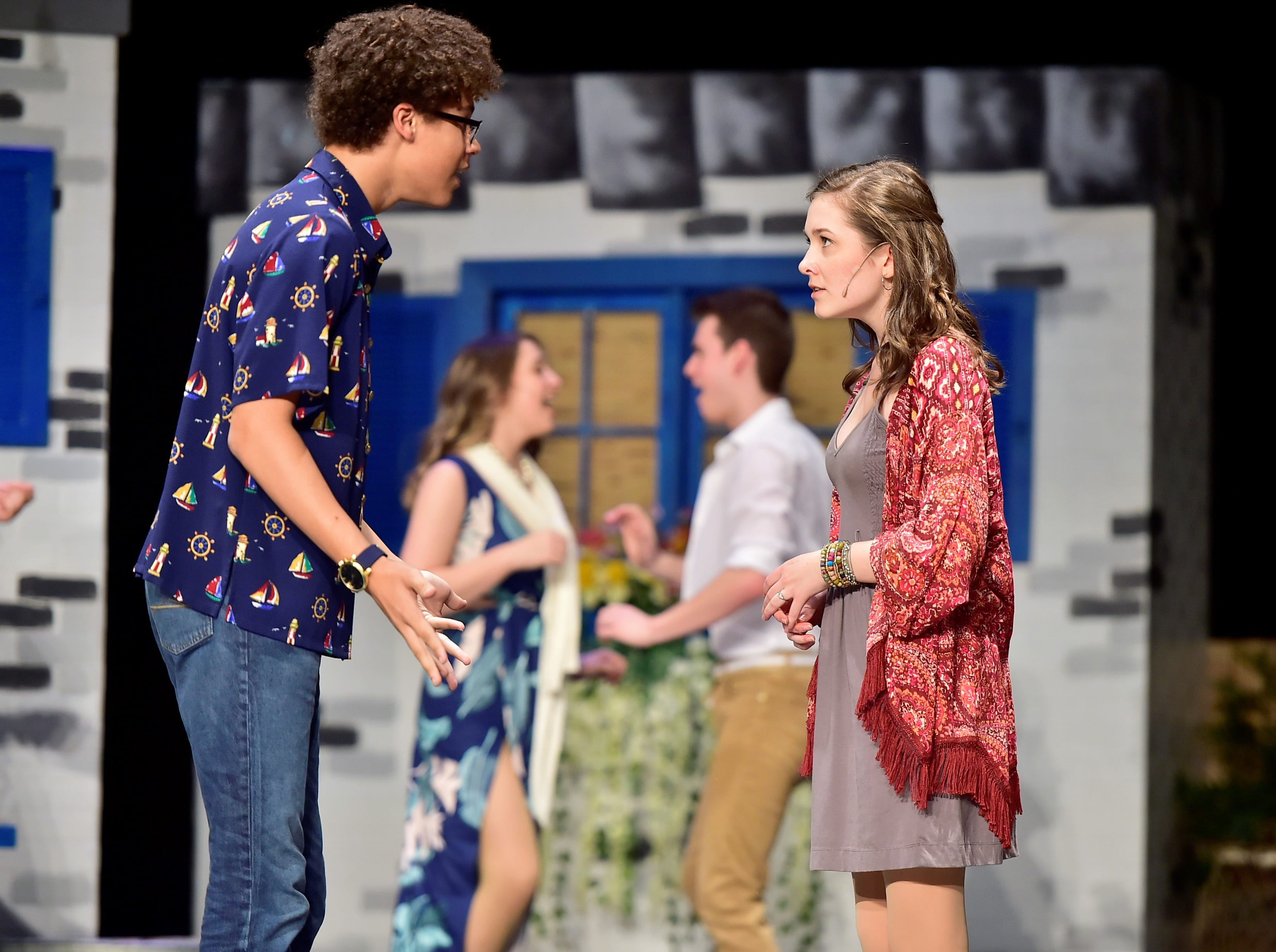 "Elijah Thomas (portraying Harry Bright) and Elise Monheim (as Sophie Sheridan) rehearse a scene from ""Mamma Mia!"" on Tuesday. The Chambersburg Area Senior High School Drama Club will perform the popular musical at 7:30 p.m. Friday and Saturday and 2:30 p.m. Saturday. Tickets ($8 for adults, $5 for students/children) will be sold at the door; no reserved seating. For more information, call 717-261-3322, ext. 80401."