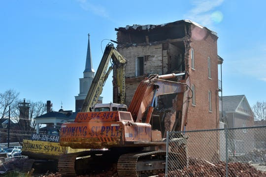 Lycoming Supply Inc., Williamsport, continues demolition of the former Wogan's Uniform Center building at 56 N. Main St., Chambersburg, on April 10, 2019.