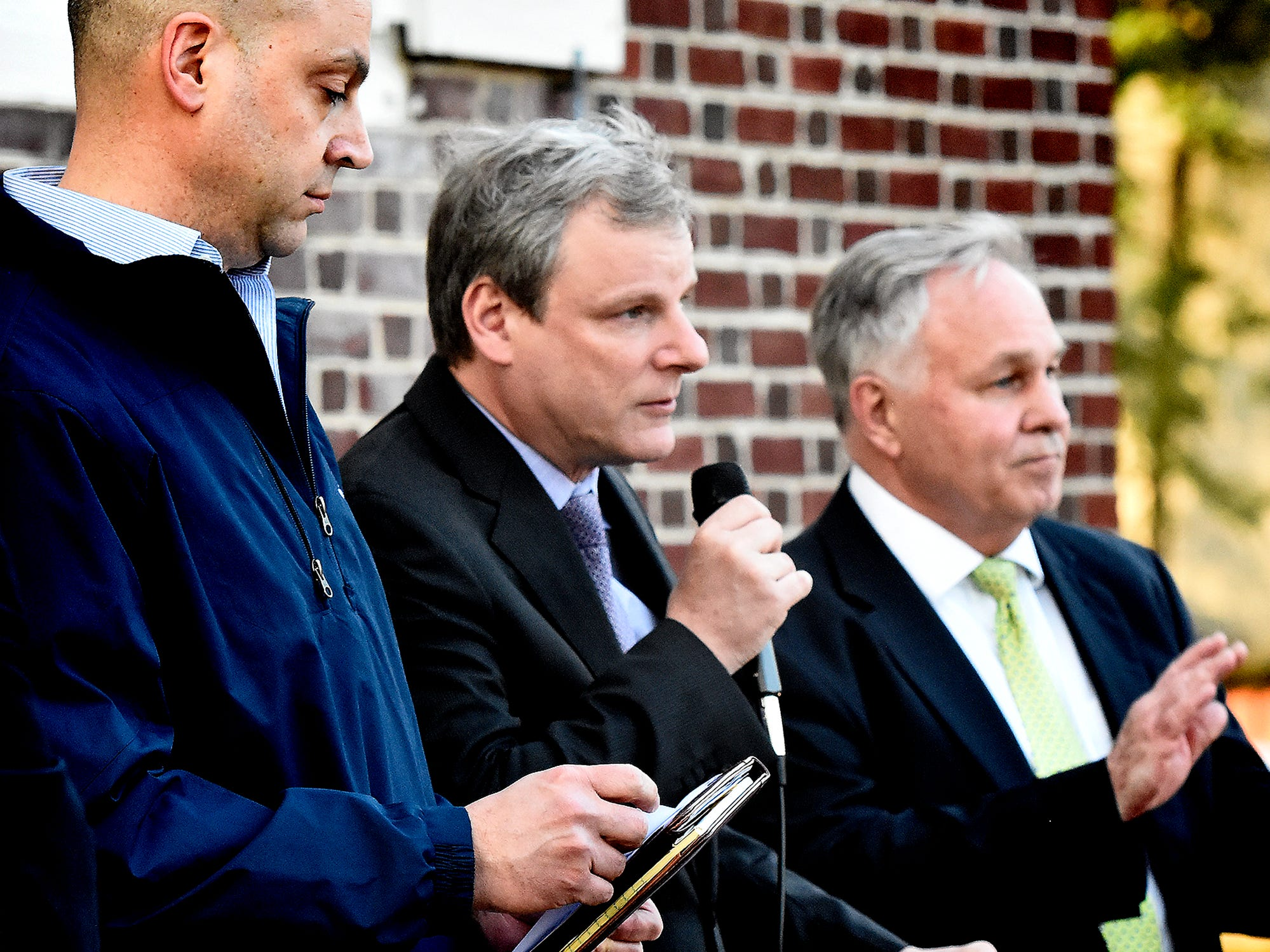 From left, York County District Attorney Dave Sunday, York City Mayor Michael Helfich and York County Commissioner Doug Hoke present a proclamation during a gathering  at the Colonial Courthouse during the 33rd annual Crime Victims' Rights March and Candlelight Vigil Tuesday, April 9, 2019. Participants gathered at the courthouse for a presentation before marching to Trinity United Church of Christ for a ceremony and candlelight vigil. The York County Victims' Rights Coalition sponsored the event to coincide with National Crime Victims' Rights Week. Bill Kalina photo