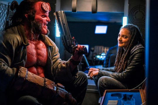 "David Harbour, left, and Sasha Lane star in ""Hellboy."" The movie is playing at regal West Manchester Stadium 13, Frank Theatres Queensgate Stadium 13 and R/C Hanover Movies."