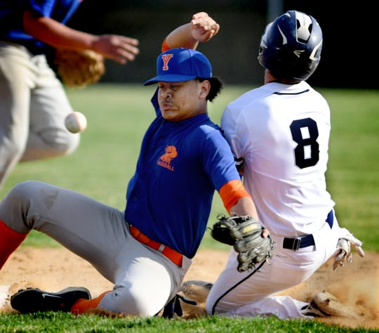West York's Trent Ketterman and York High's Erick Polanco collide at second during Ketterman's steal attempt during action at Shiloh Wednesday, April 10, 2019. Bill Kalina photo