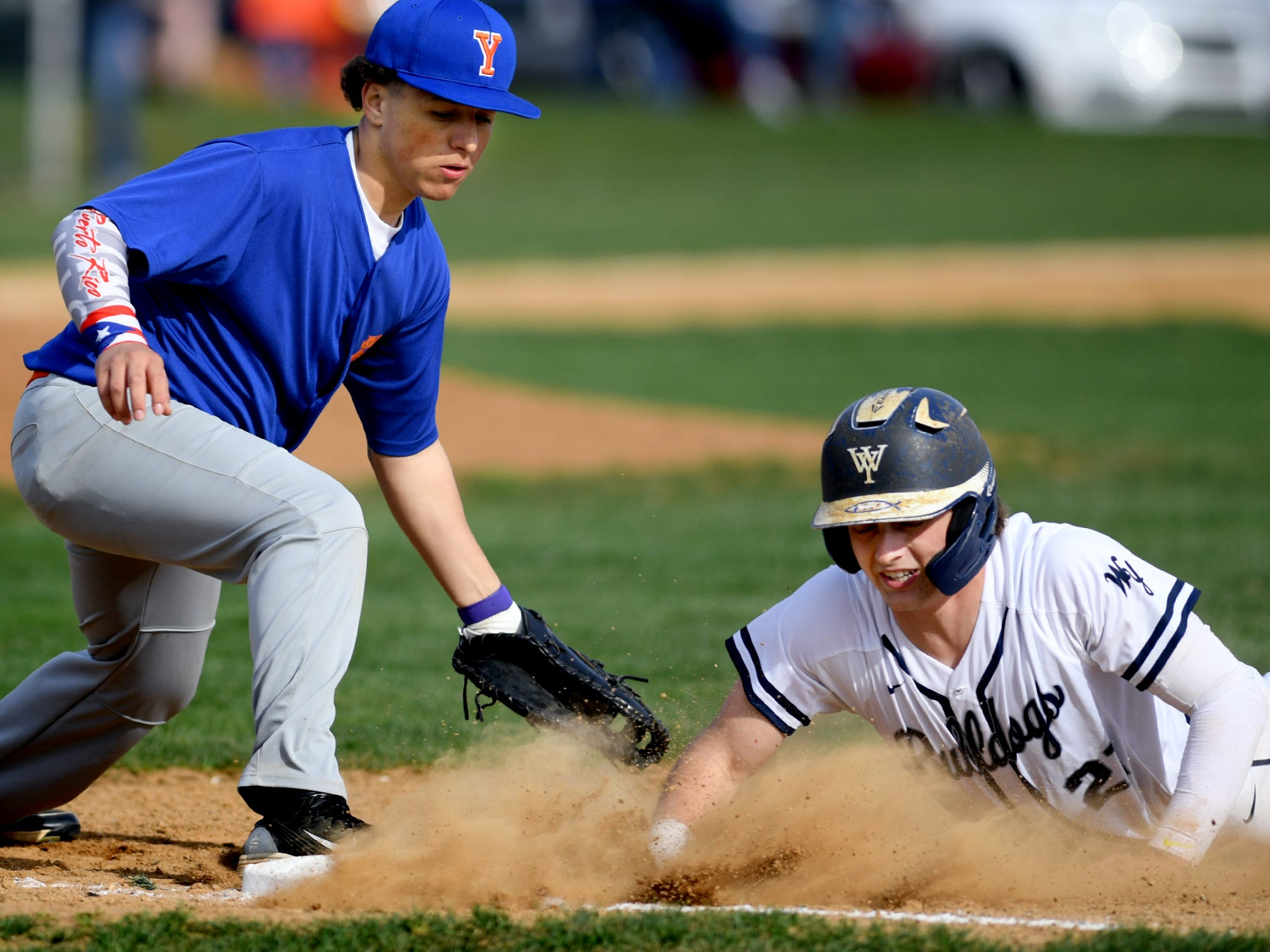 West York's Justin Wetzel gets back to first safely with York High's Dylan Rodriguez taking the throw during action at Shiloh Wednesday, April 10, 2019. Bill Kalina photo