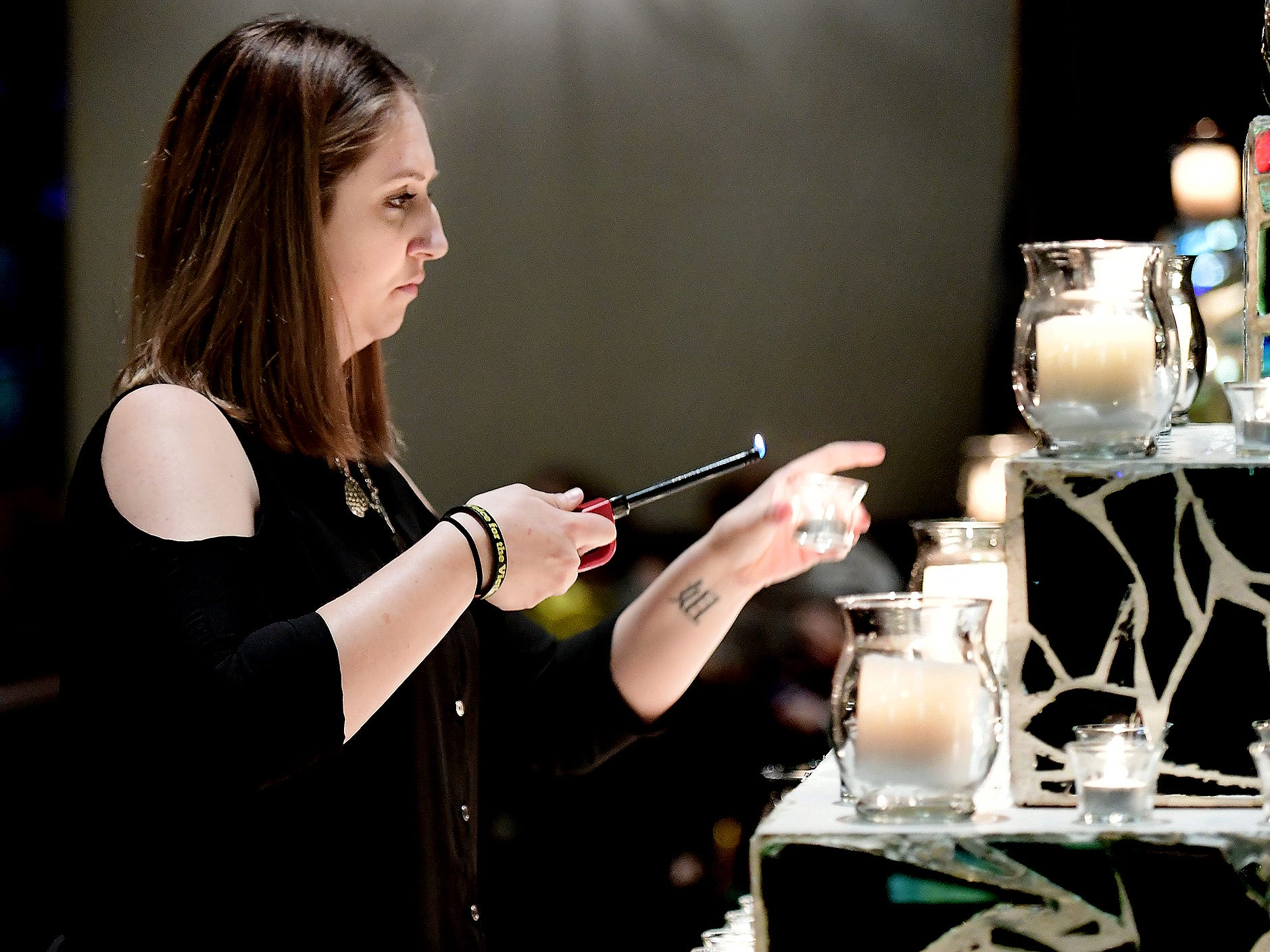 Katie Hershey of the YWCA Victims' Services Program,  lights a candles at Trinity United Church of Christ during the 33rd annual Crime Victims' Rights March and Candlelight Vigil Tuesday, April 9, 2019. Participants gathered at the Colonial Courthouse for a presentation before marching to the church for a ceremony and candlelight vigil. She volunteers for the York County Victims' Rights Coalition which sponsored the event for National Crime Victims' Rights Week. Bill Kalina photo