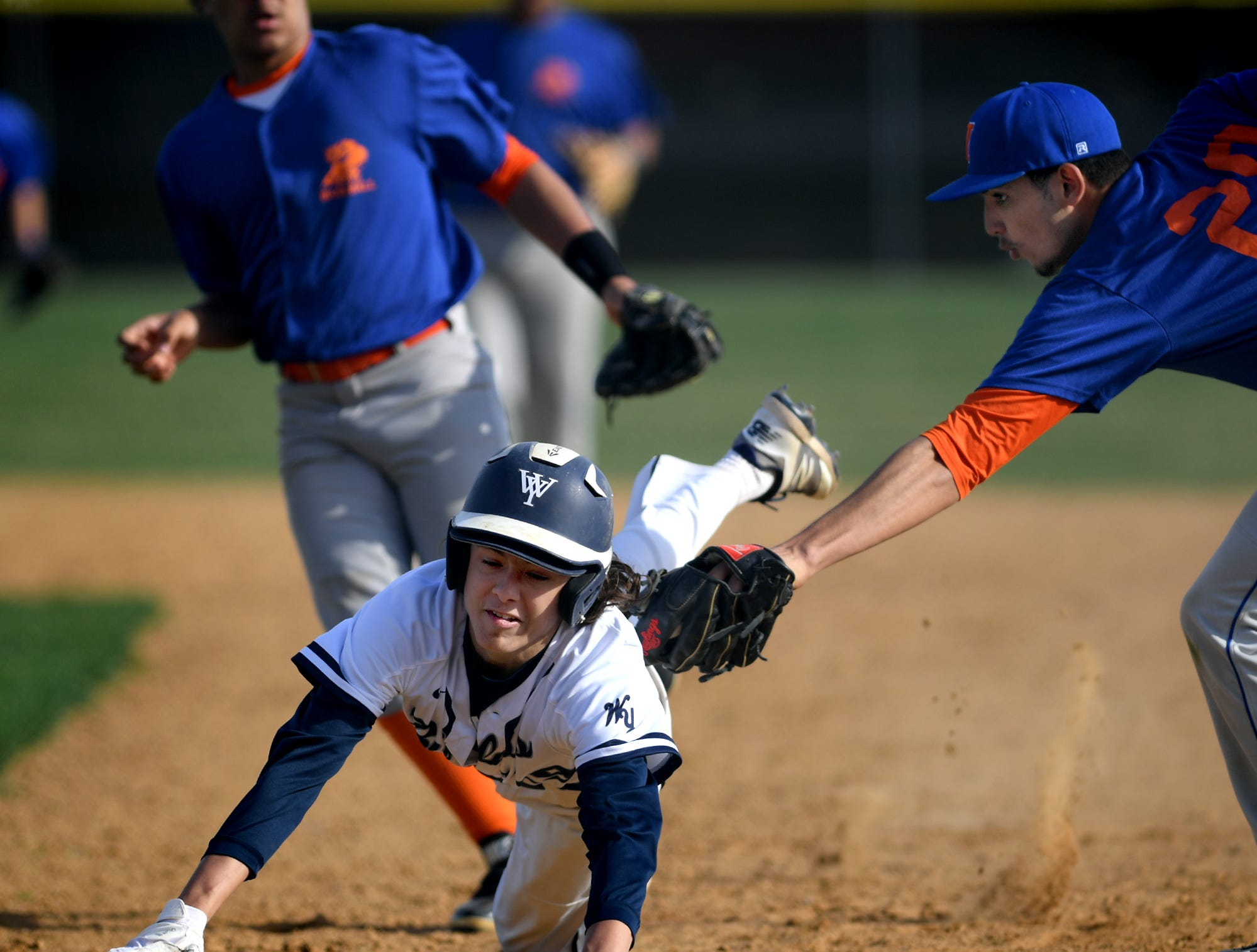 York pitcher Jose Alesandro Rodriguez puts a tag on West York's Jeff Minot who was caught in a run-down at first base with York second baseman Erick Polanco, background, during baseball action at Shiloh Wednesday, April 10, 2019. Bill Kalina photo
