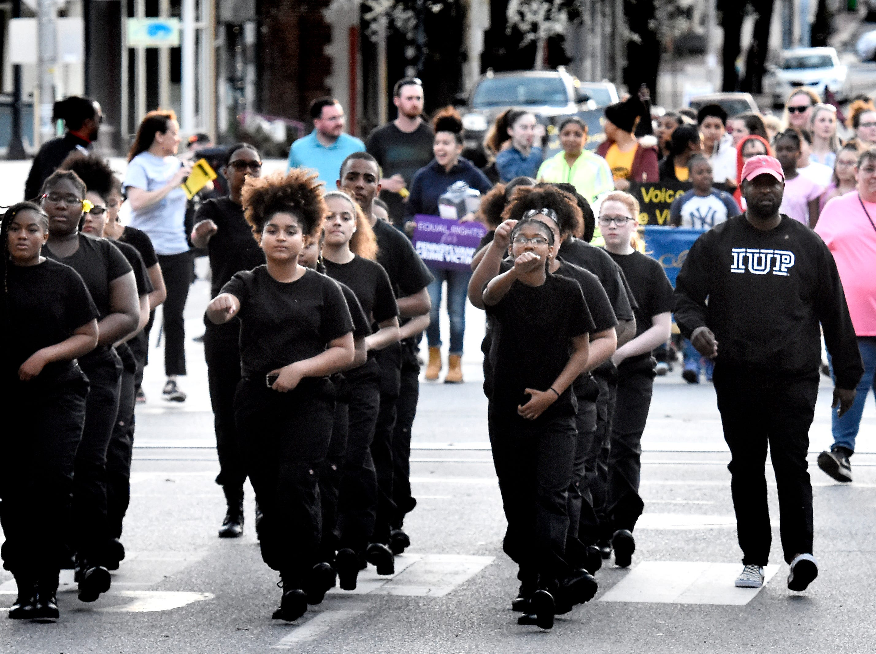 The York Temple Guard leads a march along West Market street from Colonial Courthouse to Trinity United Church of Christ during the 33rd annual Crime Victims' Rights March and Candlelight Vigil Tuesday, April 9, 2019. Participants gathered at the courthouse for a presentation before marching to the church for a ceremony and candlelight vigil. The York County Victims' Rights Coalition sponsored the event. Bill Kalina photo