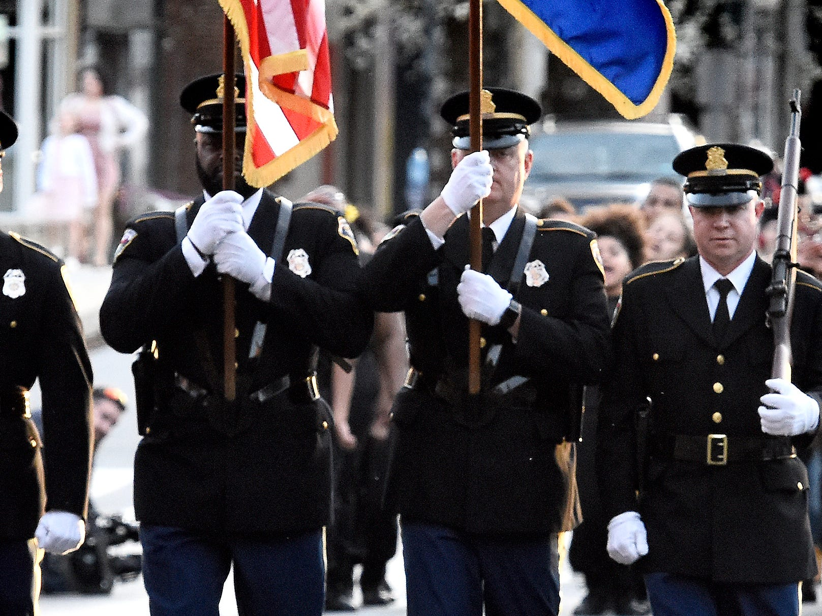 The York City Police F.O.P. Honor Guard leads a march along West Market street from Colonial Courthouse to Trinity United Church of Christ during the 33rd annual Crime Victims' Rights March and Candlelight Vigil Tuesday, April 9, 2019. Participants gathered at the courthouse for a presentation before marching to the church for a ceremony and candlelight vigil. The York County Victims' Rights Coalition sponsored the event  to coincide with National Crime Victims' Rights Week. Bill Kalina photo