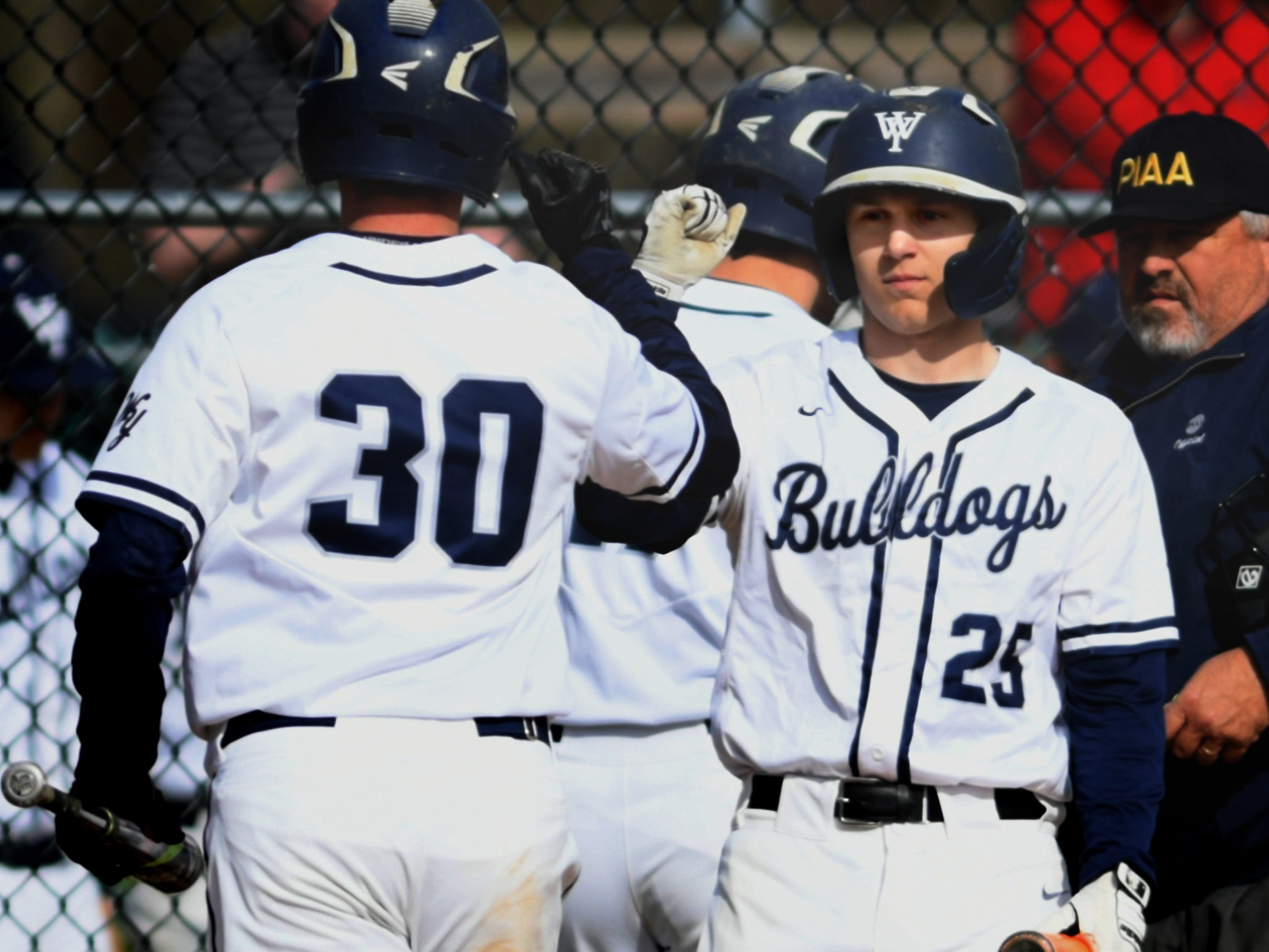 West York's Seth Eyler (30) is congratulated after scoring a run by teammate Noah Marshall during action with York High at Shiloh Wednesday, April 10, 2019. Bill Kalina photo