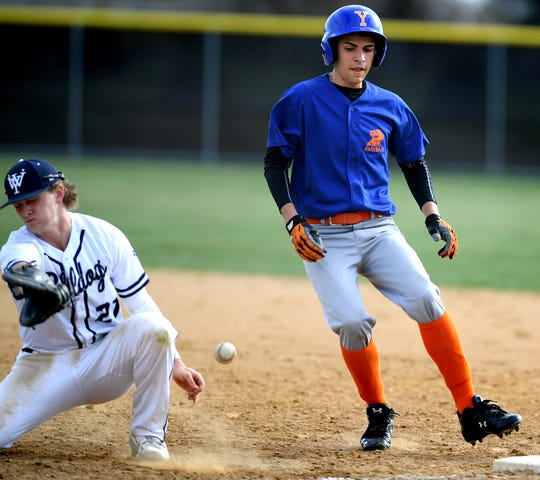 A throw gets past West York's Justin Wetzel allowing York High's Bryan Seda to advance to second during baseball action at Shiloh Wednesday, April 10, 2019. Bill Kalina photo