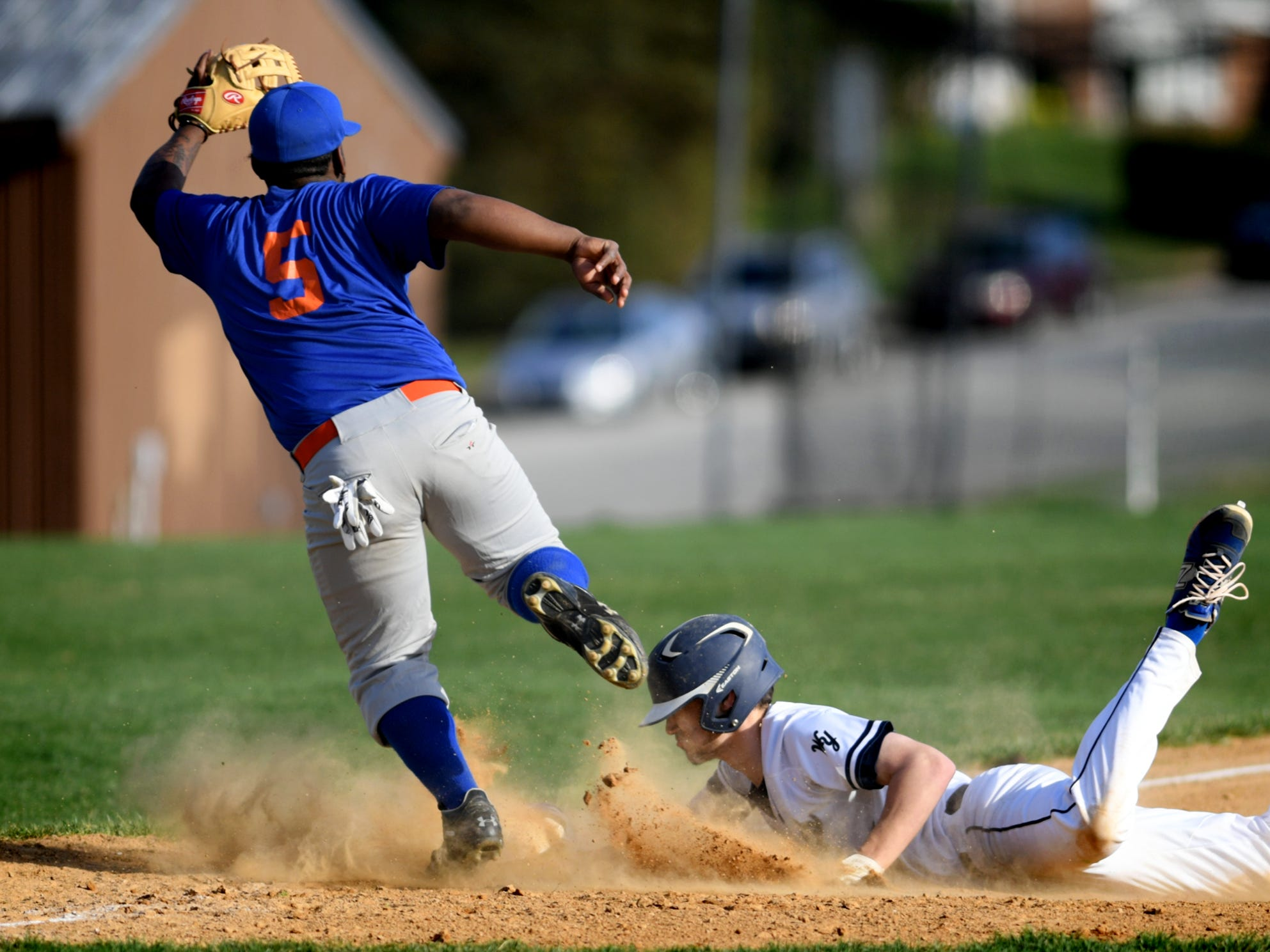West York's Jeff Minot slides into third safely with a triple as York High's Francis Rudecendo reaches for the throw during action at Shiloh Wednesday, April 10, 2019. Bill Kalina photo