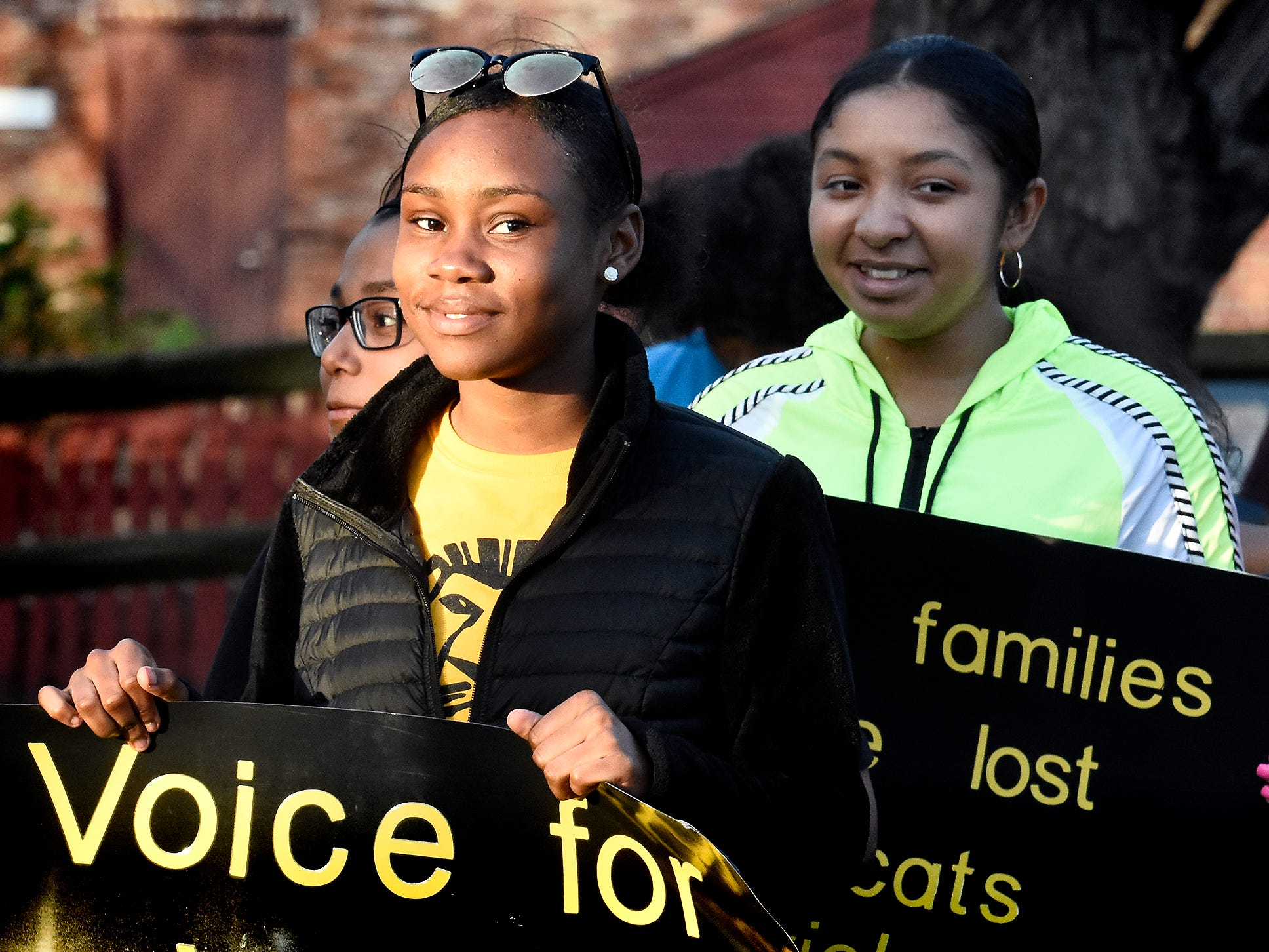 Edgar Fahs Smith STEAM Academy seventh grader India Tetteh, left, and her classmates gather during a presentation at the Colonial Courthouse during the 33rd annual Crime Victims' Rights March and Candlelight Vigil Tuesday, April 9, 2019. Participants marched from the courthouse to Trinity United Church of Christ for a ceremony and candlelight vigil. The York County Victims' Rights Coalition sponsored the event to coincide with National Crime Victims' Rights Week. Bill Kalina photo