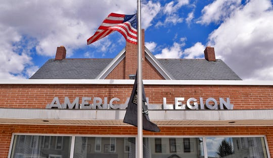 The flag flies at half-staff at American Legion Post 605 in Dallastown, where members of the post placed a sign honoring the sacrifice of Marines Benjamin Hines and Christopher Slutman, who were killed in a roadside bombing in Afghanistan on Monday. Wednesday, April 10, 2019. John A. Pavoncello photo