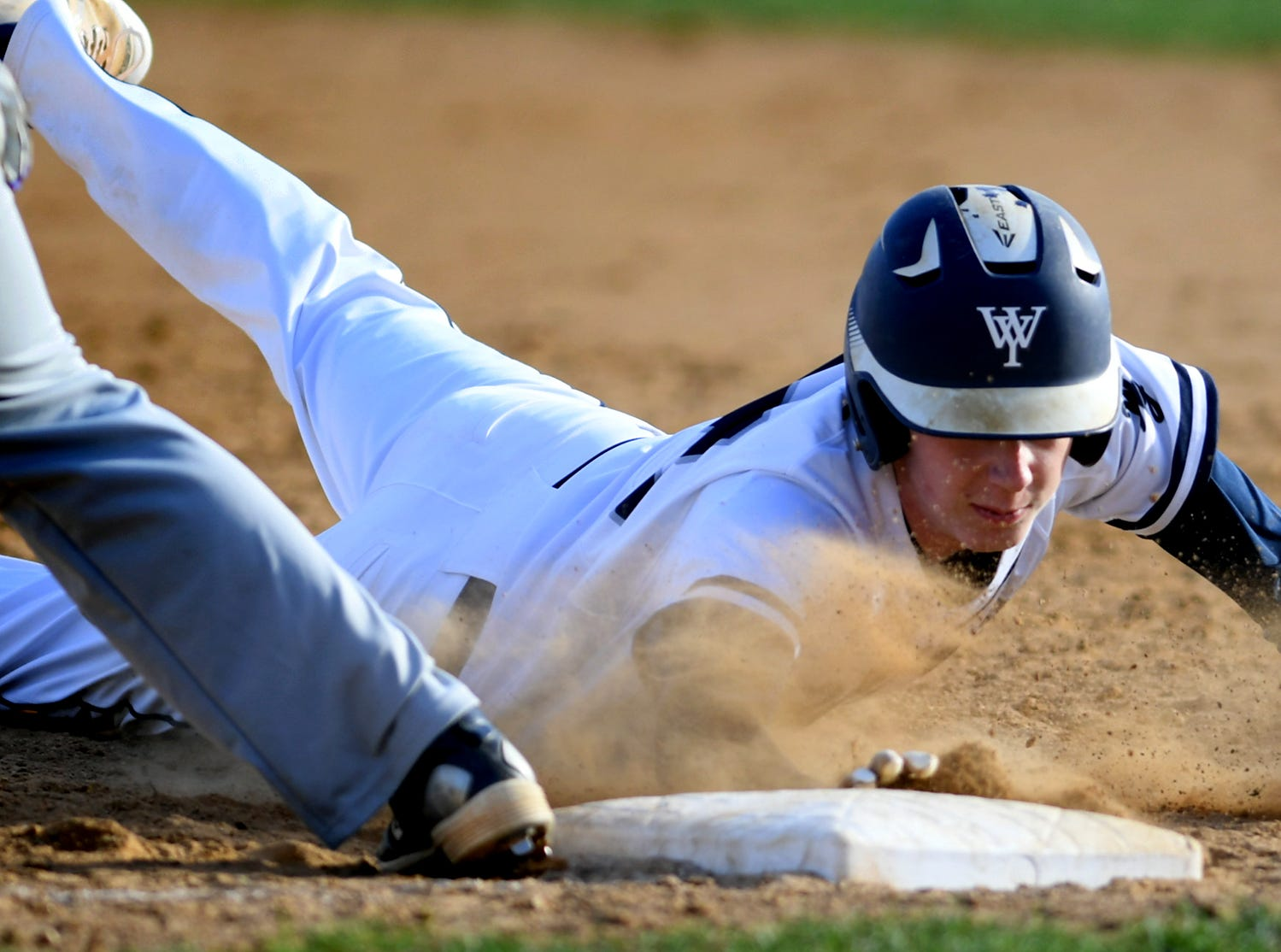 West York's Corey Wise gets back to first safely with York High's Dylan Rodriguez taking the throw during action at Shiloh Wednesday, April 10, 2019. Bill Kalina photo
