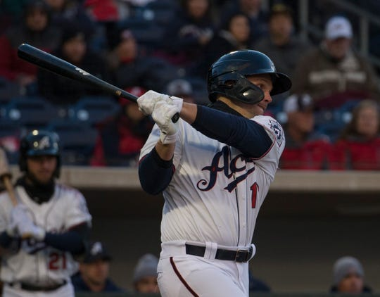 Reno Aces Travis Snider slaps a single against the Albuquerque Isotopes at Greater Nevada Field in Reno, Nevada on Tuesday, April 9, 2019.