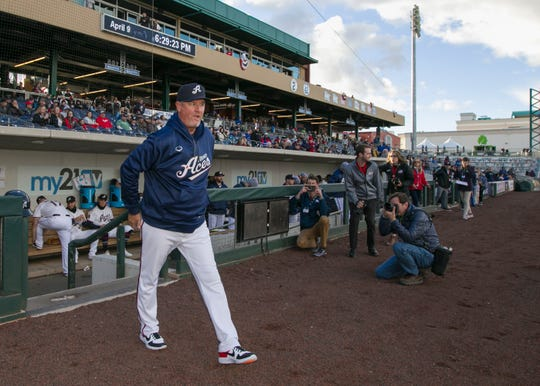 Aces manger Chris Cron takes the field before Opening Day last season at Greater Nevada Field.