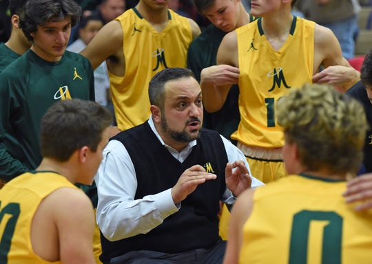 Manogue head coach Moe Golshani talks to his team during a timeout at the Wild West Shootout boys basketball tournament on Dec. 1, 2017.