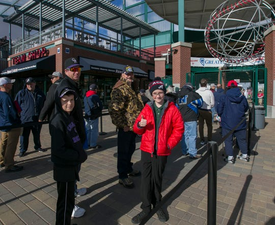 Zander Duorak, center, waits with friends and family for the gates to open on opening day for the Reno Aces at Greater Nevada Field in Reno, Nevada on Tuesday, April 9, 2019.