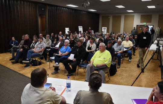 People gather at the Pershing County Community Center in Lovelock for the second round of public comments and questions on proposed changes to the Burning Man event on Tuesday evening April 9, 2019. The Bureau of Land Management hosted the event.