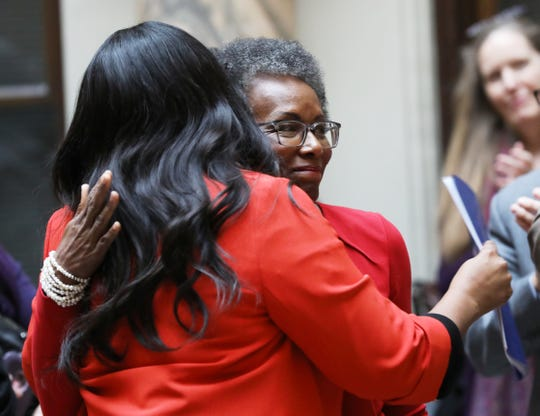 Angela D. Sims is hugged by Mayor Lovely Warren after an announcement naming Sims  the new president Colgate Rochester Crozer Divinity School.