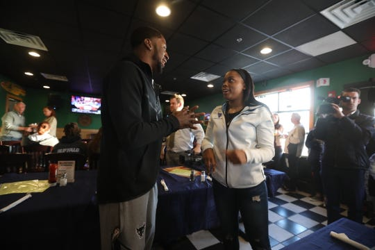 Cierra Dillard talks with childhood friend and also UB men's basketball player Dontay Caruthers. Caruthers, from Rochester, came out to support her.