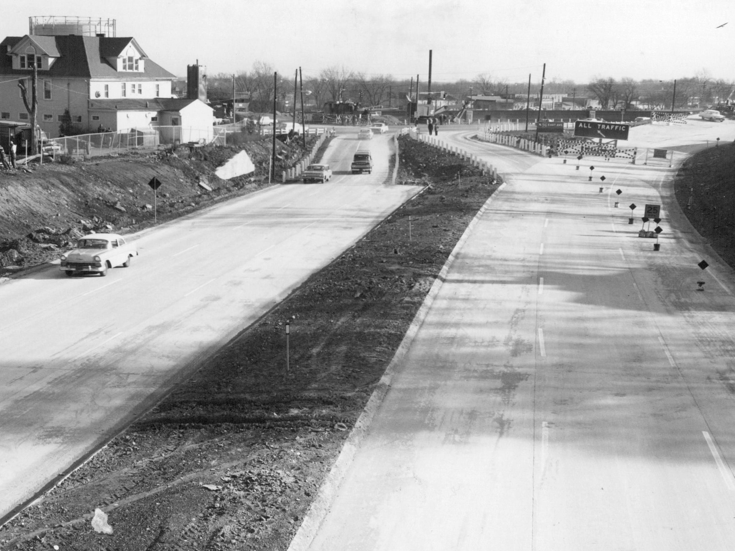 Traffic rolls over a newly opened stretch of I-490 in 1961 as seen from the Winton Road bridge.