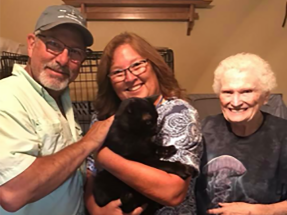Whitey-Blackie the cat was lost when his Redding home burned in the Carr Fire on July 26. Six weeks later, Carr Fire Pet Rescue and Reunification volunteers caught him and brought him home to his family. Pictured: Owners Roberta and Curtis Cole, and Betty Macintosh with Whitey-Blackie.