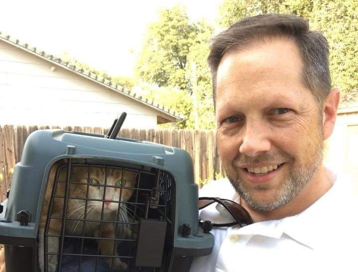 Chad Fowler welcomes home his cat Ginger in her carrier Carr Fire Pet Rescue and Reunification brought Ginger home on Aug. 16, almost three weeks after the fire forced Fowler to evacuate.