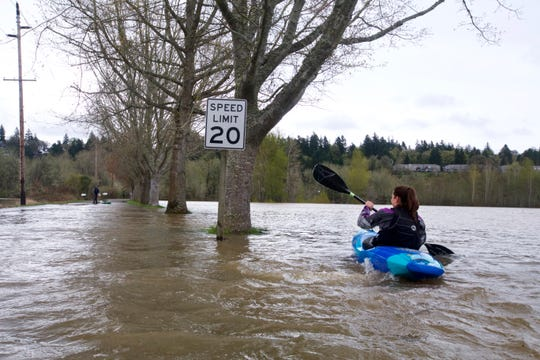 Priscilla Macy kayaks a flooded road at Minto-Brown Island Park as the Willamette River rose to 25 feet — its highest level since 2012.