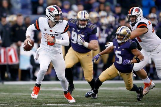 Oregon State Beavers quarterback Jake Luton (6) tries to get away from Washington Huskies defensive back Myles Bryant (5) during the third quarter at Husky Stadium on Nov. 17, 2018. Mandatory Credit: Jennifer Buchanan-USA TODAY Sports