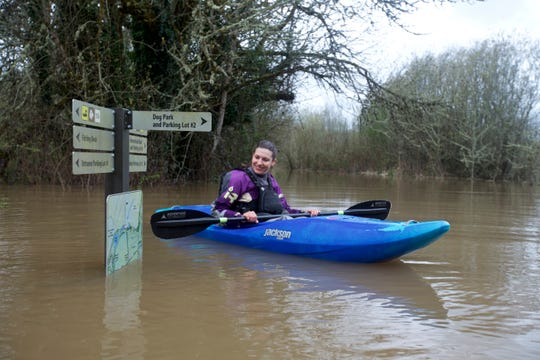 Priscilla Macy kayaks through the flooded forest of Minto-Brown Island Park as the Willamette River rose to 25 feet — its highest level since 2012.