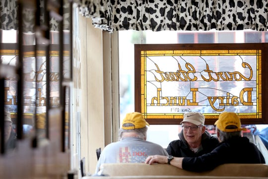 Friends Lou Black, facing, Jerry McCubbins, left, and Lon Lembert, all of Salem, talk for their weekly breakfast meet-up at the Court Street Dairy Lunch in downtown Salem on April 10, 2019. The old-fashioned diner opened in 1929 and is the city's oldest restaurant.